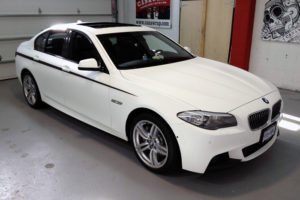 3M1080 Matte White BMW Wrap With Black Carbon Fiber Details